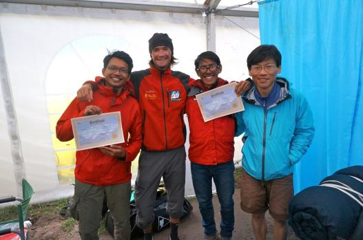 Being awarded the certificate of completion with the team of climbers and guides